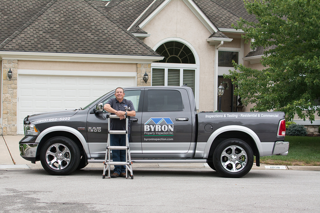 John Byron and his truck with Byron Property Inspections, INC logo