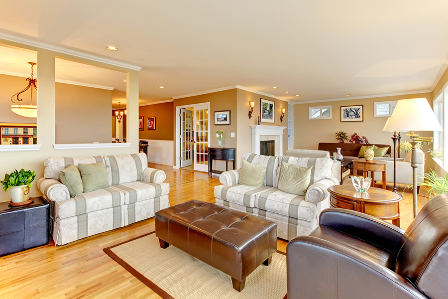 Large luxury living room with beige walls.
