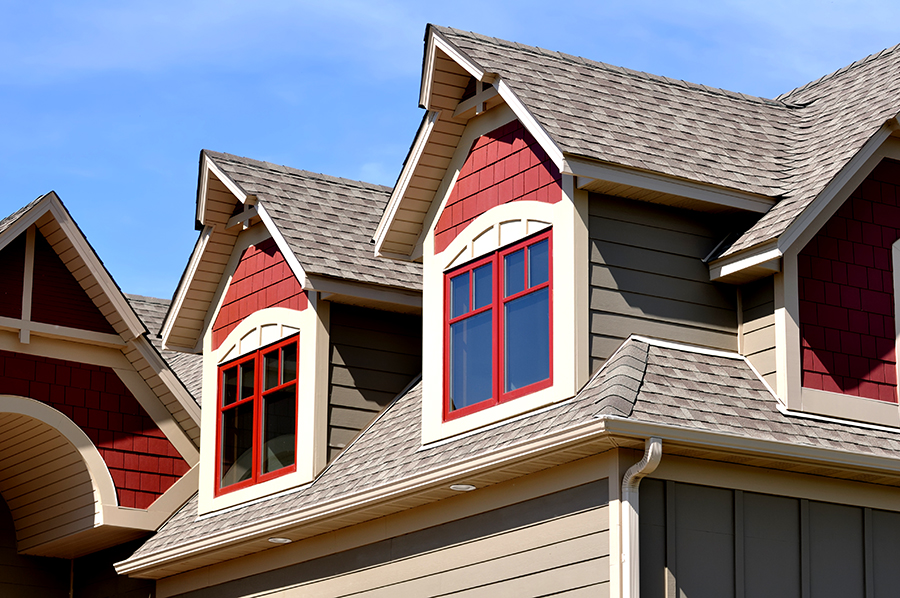Gable Dormers and Roof of a Red Residential House